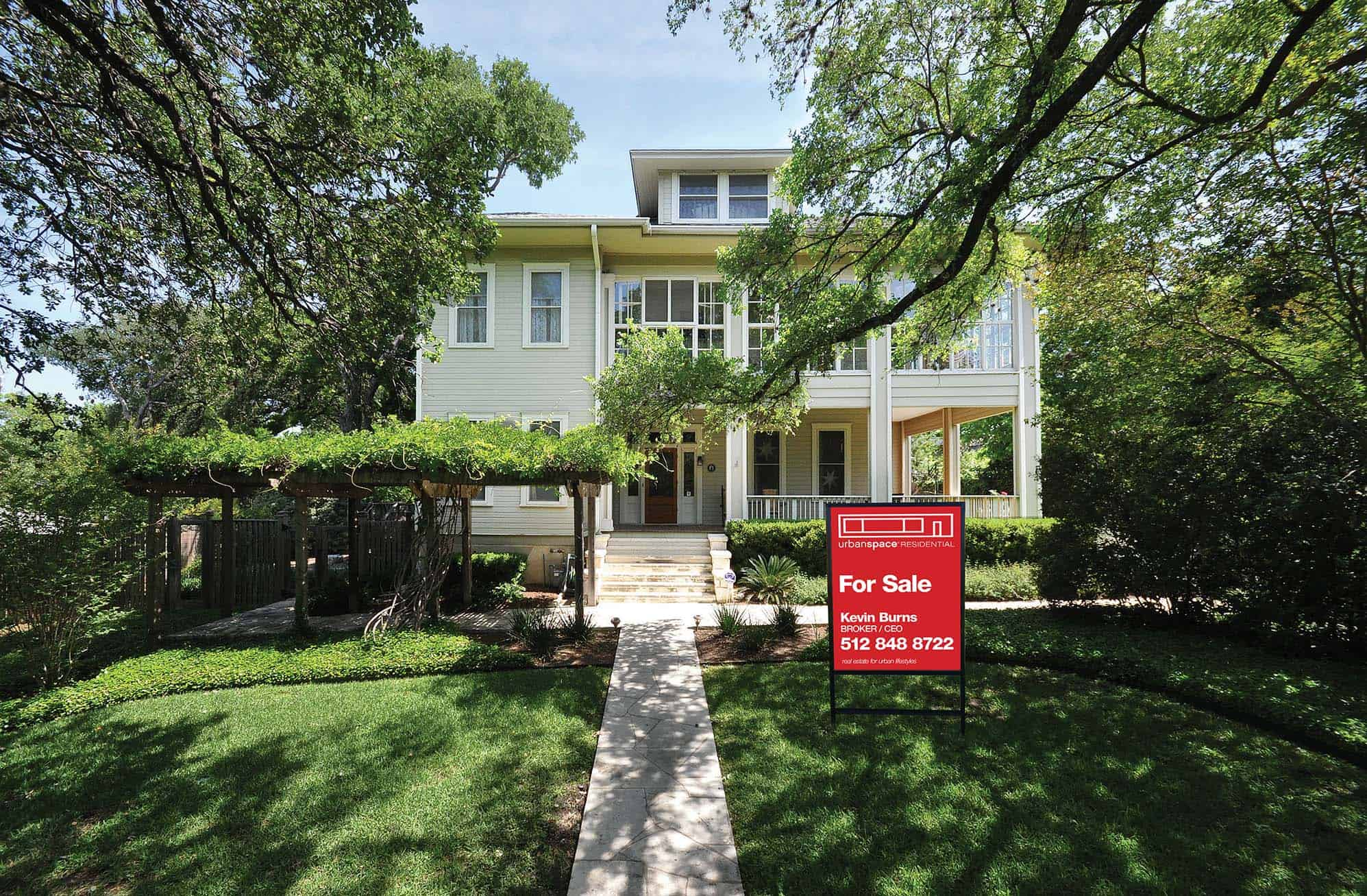 house exterior with for sale sign in yard urbanspace realtors austin